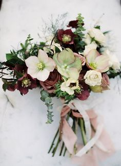 Lovely style for the bridesmaids. Helleborus should be in season and make lovely statement flowers.