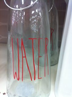 Glass water bottle with cute label