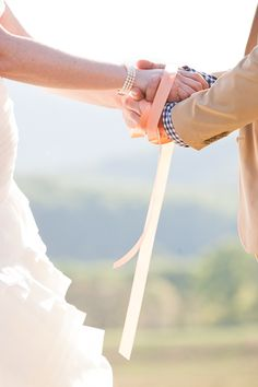 Handfasting, an ancient Celtic tradition of tying the bride's and groom's hands with a cord or ribbon to signify entering into the contract of marriage.