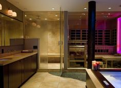 The gorgeous bathroom doubles as a personal spa. There's a steam shower, whirlpool bath, and sauna, which you get to by treading on a reflexology path. Plus, the lighting isn't just flattering: One offers therapy to help alleviate the winter blues and several chromotherapy lights change hue to enhance mood or promote relaxation.