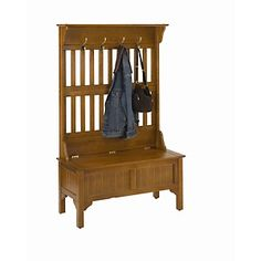 Home Styles Hall Tree and Storage Bench features hardwood and veneer construction in an oak finish. Features full lift top storage bench with safety hinge and four large brass hooks. Size: in. W x 18 in. D x 64 in. Hall Tree Storage Bench, Small Entryway Bench, Entryway Hall Tree, Hall Tree Bench, Entryway Storage, Entryway Furniture, Bench With Storage, Furniture Decor, Hall Trees