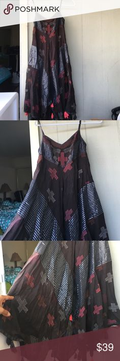 Free people lined asymmetrical Geo pattern midi Excellent used condition. Women's extra small. Authentic free people. Colors are black silver and reds Free People Dresses Midi