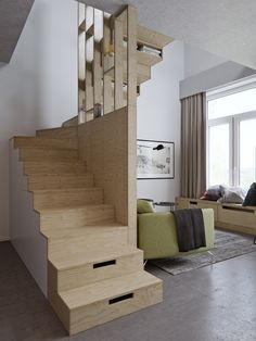 A grand feature in an apartment can make a space look larger. The winding, wooden staircase makes a statement while affording a clean, non-intrusive backdrop for other elements.