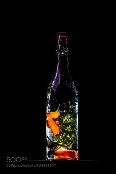 Pic: Dill and carrots on water in a bottle. So its li