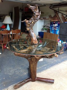 Driftwood table - handmade and high end in Toddandmedessa's Garage Sale in Branson , MO for $500. This table is perfect for the rustic look or cabin or lake house. Come with a natural center piece driftwood sculpture.