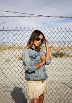 Spring / Summer - street chic style - boho chic style - khaki sleeveless fringe mini dress + distressed denim jacket + black sunglasses