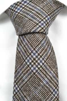Dino has a glencheck pattern in darkest brown & bright blue. A classic bestseller inspired by Britain.