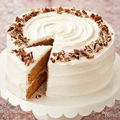 Try this moist carrot cake recipe along with a homemade cream cheese frosting recipe that will blow your mind! Easy and delicious, this layered carrot cake is stacked high with light and fluffy cream cheese icing. Top with to/