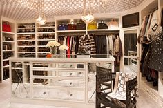 A high-profile lifestyle calls for a high-class closet. With enough space to fit more shoes than we can even dream of, Jenner's closet is complete with a mirrored center island, a patterned ceiling, and designated storage shelving with a Birkin to go with every blazer.