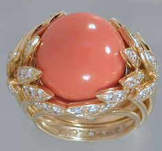 Large Salmon color Coral Cabochon encircled by Diamond-studded Gold Leaves