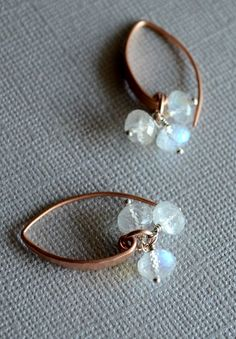 Flashing rainbow moonstone and rose gold earrings. By Kahili Creations of Hawaii...