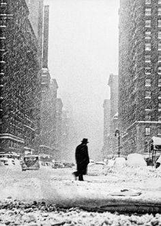 a somewhat bleak commute for this man caught up in a vicious new york snowstorm. the city is known for its extreme weather: freezing cold winters, humid and stifling summer, 1947. [original] ©ted croner,fromnew york. portrait of a city.