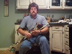 An Uilleann piper. The Uilleann Pipes are arguably the hardest instrument to play, bar none. http://www.youtube.com/watch?v=pLReGq4oagU