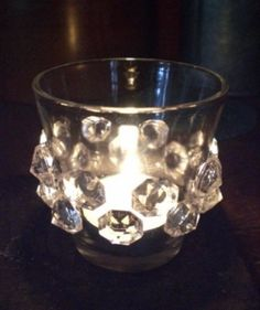 Crystal votive - how clever is that?  Crystals from old chandelier parts, bobeches and the like with glass glue.