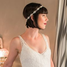 Throwing a vintage-inspired wedding? Erin's scalloped headband from Brides of California exudes Great Gatsby sophistication.