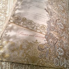 Magical mixed metals and intricate paper lace on the engraved custom wedding invitation with lasercut wrap.