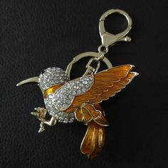 Aliexpress.com   Buy Fashion 3D Metal Flying Bird Keychain with Rhinestone  Crystal Gold Color Plated Yellow Bird Key Chain for Women Bag Pendant from  ... 8cdc53f996