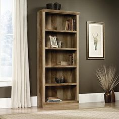 The East Canyon Bookcase comes in a two-toned brown and honey craftsman oak finish. Features 5 wide and tall shelves to allow for a versatile display of your collection of books and other belongings. Contrasted wood paneling creates a pleasing textured look. East Canyon Bookcase | Weekends Only Furniture and Mattress