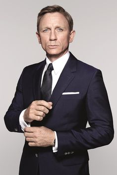 James Bond in Spectre... Flat colors, classic shirt collar, straight pocket square, and French cuffs... Be more like 007