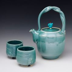 """Teapot 52"" ceramic tea set by #ceramic #artist Ron Mello. One of a Kind. Wheel thrown porcelain teapot with sprung and twisted handle, natural turquoise, copper, and brass fittings. Very soothing."