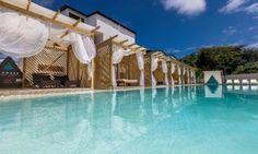 Groupon - Stay at Ahnvee All-Inclusive Resort and Sports in Sosúa, Dominican Republic. Dates into December. in Sosúa, Dominican Republic. Groupon deal price: $162