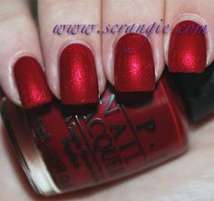 OPI Danke-Shiny Red. A super shiny metallic red with a silly name. It's so metallic and luminous that it's hard to capture the true color because it glows too much. It's a cooler toned red, medium bordering dark, with a smooth, shiny, almost chrome-like metallic finish. Think Zoya Elisa, just cooler and darker.