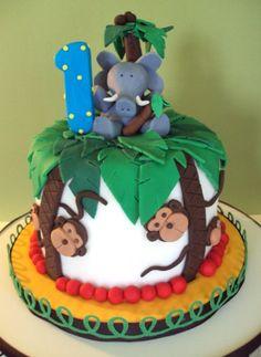 Baby's Jungle theme Birthday cake by TheFlourBasket