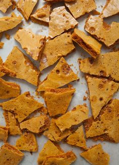Autumn has finally arrived in LA and I'm rolling in it like a dog in recently fertilized grass. Yesterday I put on my fluffiest of fluffy socks, put Notting Hill on the TV and baked my lil' heart away—it was my favorite Sunday. One of the things that has been on my... #candy #foodgift #honey Candy Recipes, Snack Recipes, Dessert Recipes, Cooking Recipes, Snacks, Nut Recipes, Honeycomb Recipe, Honeycomb Candy, Sea Foam Candy