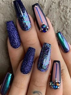 "If you're unfamiliar with nail trends and you hear the words ""coffin nails,"" what comes to mind? It's not nails with coffins drawn on them. It's long nails with a square tip, and the look has. Edgy Nails, Dope Nails, Fancy Nails, Stylish Nails, Bling Nails, Blue Glitter Nails, Purple Glitter, Red Purple, Silver Glitter"