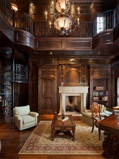 Two story paneled libraries, love it!