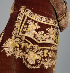 Detail pocket flap, coat, France, 1760-1780. Grape silk velvet with polychrome silk embroidery and embroidered buttons.