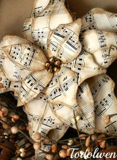 Poinsettias - made from vintage sheet music, mercury glass beads, glitter, wire and glue. How pretty is this! Handmade Christmas Decorations, Vintage Christmas Cards, Rustic Christmas, Christmas Projects, All Things Christmas, Christmas Home, Christmas Holidays, Christmas Ornaments, Christmas Music