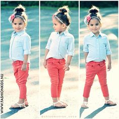 Coral skinny jeans and blue button shirt.