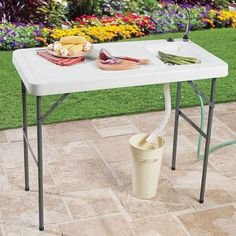 """Simply hook this versatile outdoor sink table up to your standard garden hose and enjoy fresh, clean water anywhere outdoors! Durable resin is convenient for food prep, gardening and more, making it perfect for tons of outdoor activities.   sturdy fold-out aluminum legs chrome-plated faucet easily portable for storage and transport with drainage hole imported wipe clean dimensions: 37""""H x 23½""""W x 45""""L BrylaneHome offers the best of everything you need for outdoor living. Sho..."""