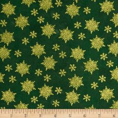 Holiday Traditions Metallic Snowflakes Green  from @fabricdotcom  Designed by Whistler Studios by Windham Fabrics, this traditional Christmas cotton print collection is perfect for quilting, apparel, and home decor accents. Colors include green and metallic gold.