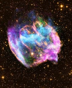 Youngest black hole? This Chandra X-Ray Observatory image, obtained Feb. 26, shows a highly distorted supernova remnant that may contain the most recent black hole formed in the Milky Way galaxy. The color-coded composite image of the supernova remnant W49B combines X-rays from Chandra (blue and green), radio data from the Very Large Array (pink) and infrared data from the Palomar Observatory (yellow).