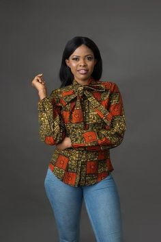 Step up your fashion game in this simple yet classy top. It could be dressed up in a pencil skirt and heels for work or make it casual chic with a pair of jeans & flats! Self -tie pussy bow detail Back zipper African Fashion Designers, African Fashion Ankara, Latest African Fashion Dresses, African Print Dresses, African Print Fashion, Africa Fashion, African Wear, African Attire, African Outfits