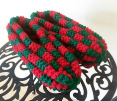 These soft, cozy slippers are made with two colors of acrylic yarn, red and green. Size compares with a shoe size 7 - 7 Machine wash and dry. Made in a smoke free, pet free environment. Knitting For Beginners, Knitting Ideas, Hand Knitting, Knitting Patterns, Knit Slippers, Craft Items, Crochet Flowers, Sample Resume, Needlework
