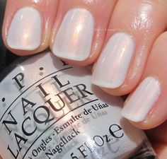 OPI Oh My Majesty!, a glowing soft white with tons of beautiful golden pink shimmer.
