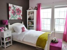 A+warm+chocolate-brown+focal+wall+adds+an+adult+edge+in+this+girl's+bedroom.+To+make+the+rich+hue+more+playful+and+fitting+for+a+young+girl,+HGTV+fan+wenbenoit+integrated+hot+pink+into+the+design+scheme+with+sheer+window+treatments,+storage+ottomans+and+a+stylish+floral+lamp.+She+kept+the+linens+ultra-neutral+to+offset+the+bold+color+combination.