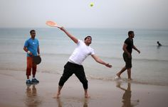 A Palestinian man plays a bat and ball game during a warm day on Gaza City beach along the Mediterranean Sea March 27, 2015. REUTERS/Mohammed Salem
