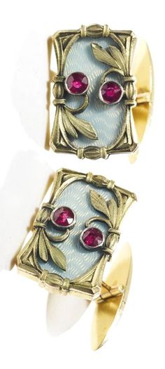 A PAIR OF RUSSIAN JEWELED GOLD AND GUILLOCHÉ ENAMEL CUFFLINKS, 6TH JEWELERS' ARTEL, MOSCOW, 1908-1917 the links shaped rectangular, enameled with translucent oyster over a wavy guilloché ground, applied with gold foliage and faceted gemstones, with hinged bar fittings, 56 standard width 3/4 in. (2 cm)