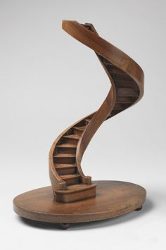 Spiral staircase model with curved stringboards, on a circular base on bun feet.
