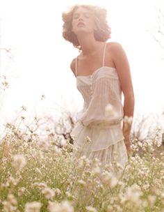 white dress in a field of flowers