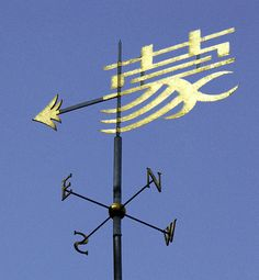 """The weather vane stands on the William M. W. Mong Building which was opened by H. M. The Queen on 8th March, 1996.    Her Majesty's visit visit to the College was to mark the quatercentenary of its foundation, in which the support of the first Queen Elizabeth had been crucial.    The Chinese character respresented in the weather vane signifies """"house"""", """"home"""" or """"family"""", the aptness of which will be felt by members of the College."""