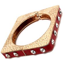 "This square, enamel constructed, hinged bracelet is adorned with crystal studs and textured. The fashion bracelet is metal casting and nickel and lead compliant. Size: 1/2"" Width 