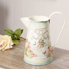 A fabulous way to display fresh or silk flowers, this gorgeous and bright pitcher jug is a beautiful addition to a mantel piece or windowsill. Featuring a stunning vintage and floral design, the jug also has a large curved handle for added decoration. A lovely gift idea for a friend or loved one, this jug can be used all year round in your home.