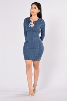 Available in Dark Denim Lace Up Front Long Sleeve Form Fitting Side Zipper 84% Cotton, 13% Polyester, 3% Spandex