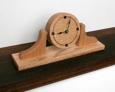A wooden clock with tilting round face by www.davidtowers.biz