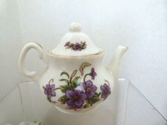 Wonderful Little Lefton China 3 Teapot Decorated with Purple Violets. Dated 1997. #11113 Labels in perfect condition.No chips, cracks, or crazing.
